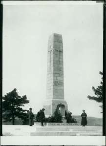 The Whanganui Cenotaph in around 1924 with a group of people inspecting the wreaths laid for the Dawn Service
