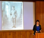 Kirsty Ross delivers her speech, accompanied by some images of soldiers