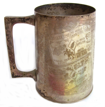 1. Tankard engraved by H Drew